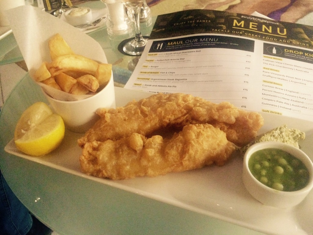 A plate of chunky chips, beer-battered haddock and mushy peas with tartare sauce