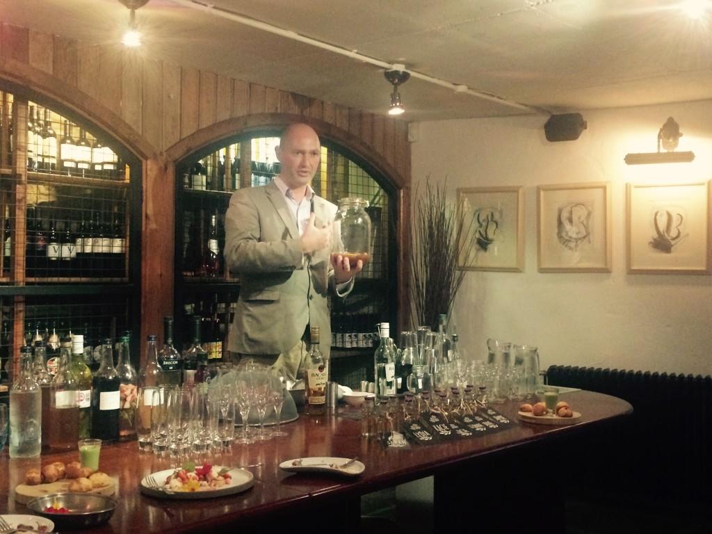 Manager, Ronan Hunter demonstrates Newbridge's infused spirit range