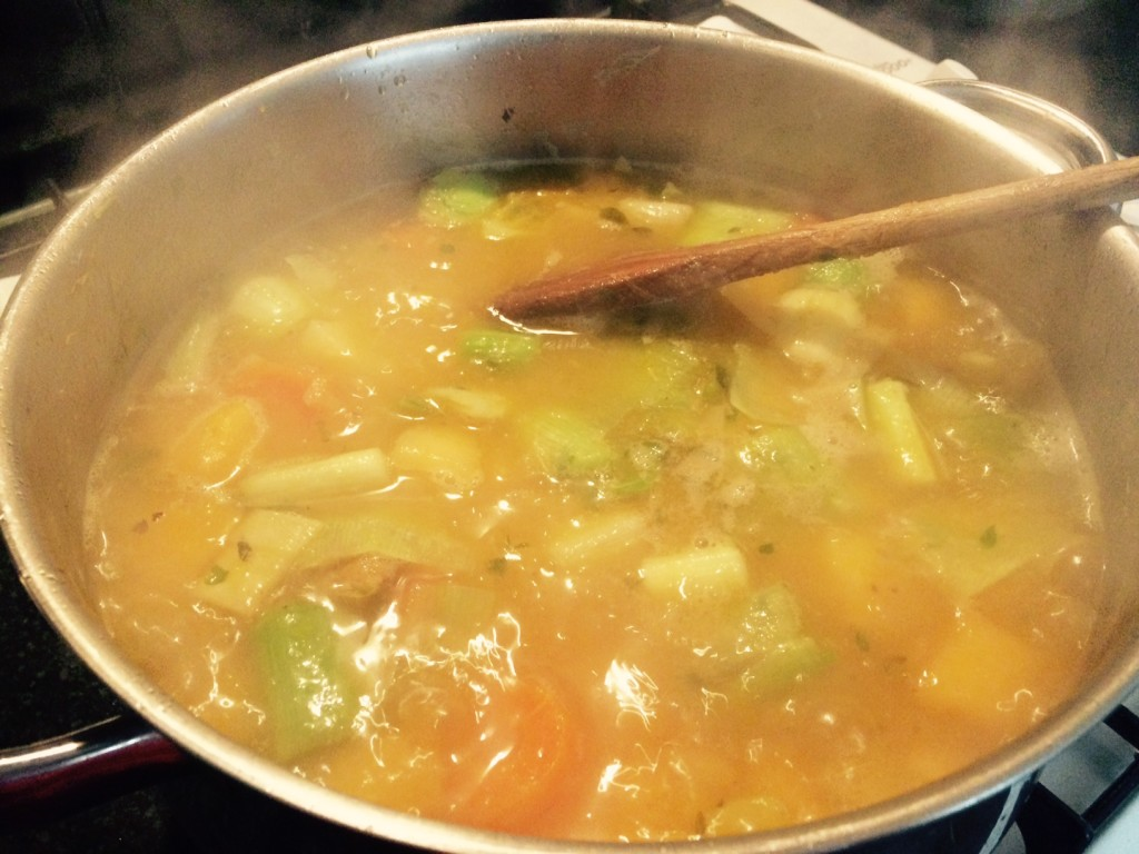 A large pot of stew simmering on the stove