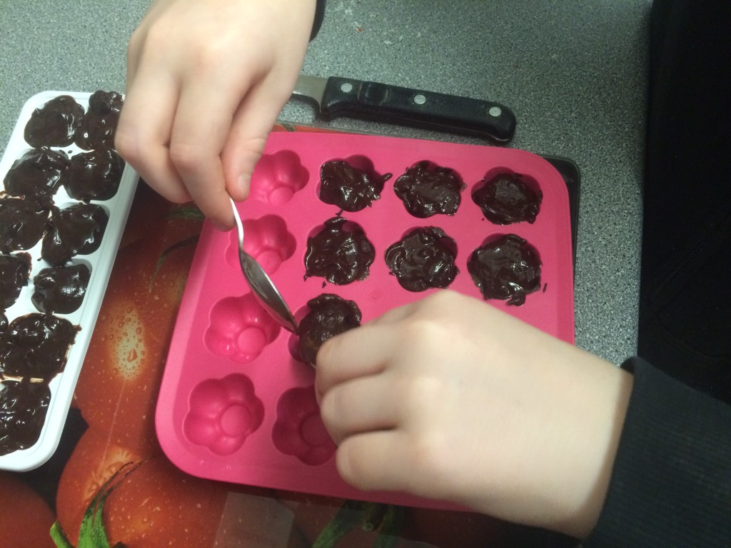 Transferring the chocolate mixture into the moulds