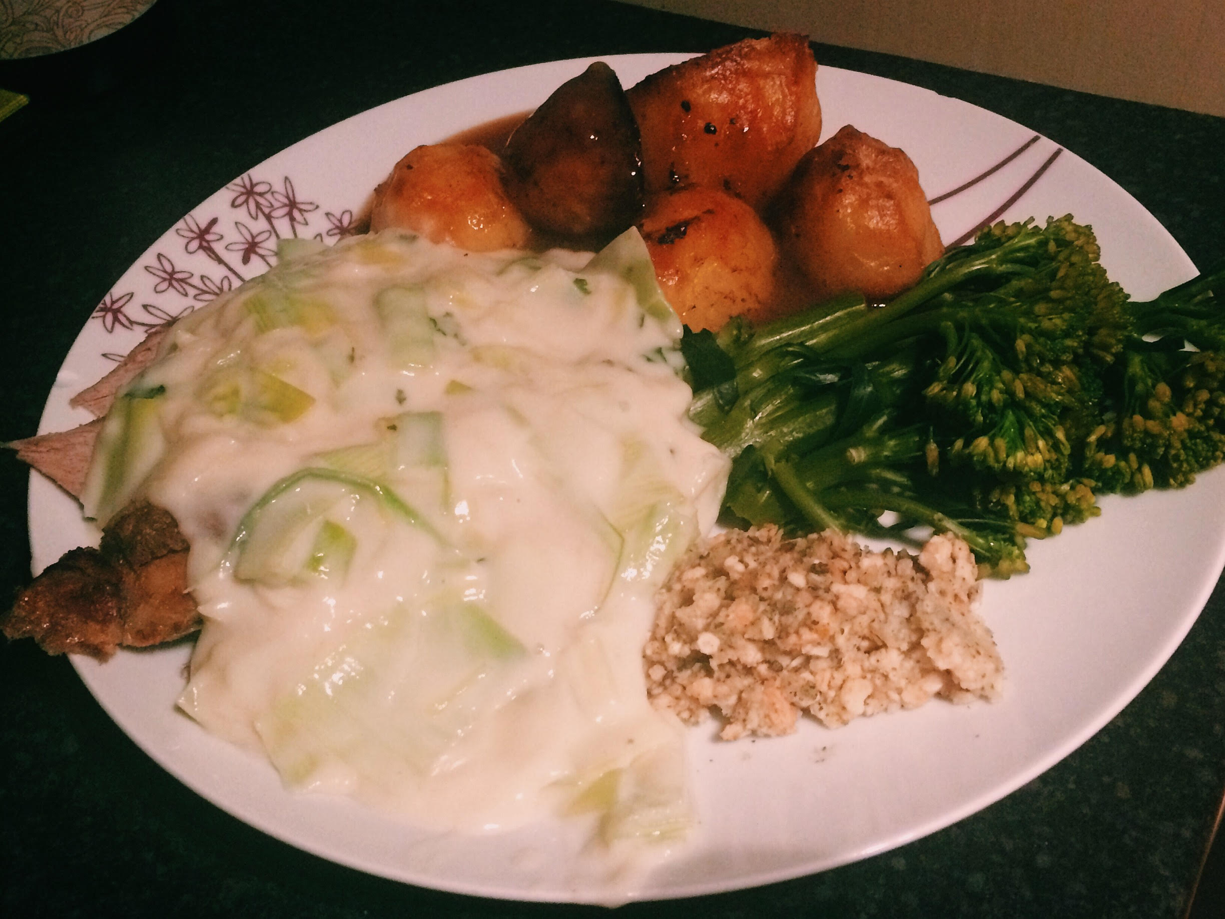 Lamb roast dinner topped with leek and mint sauce