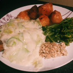 Lamb with mint and leek sauce, broccoli and roast potatoes