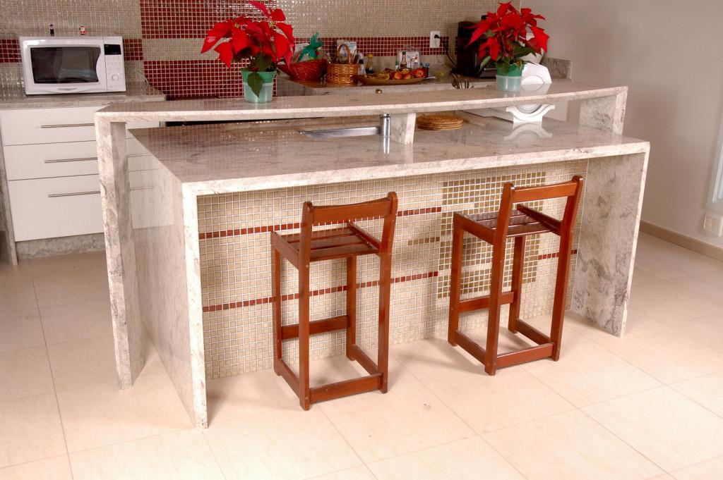 A modern, clean kitchen decorated with poinsiettas