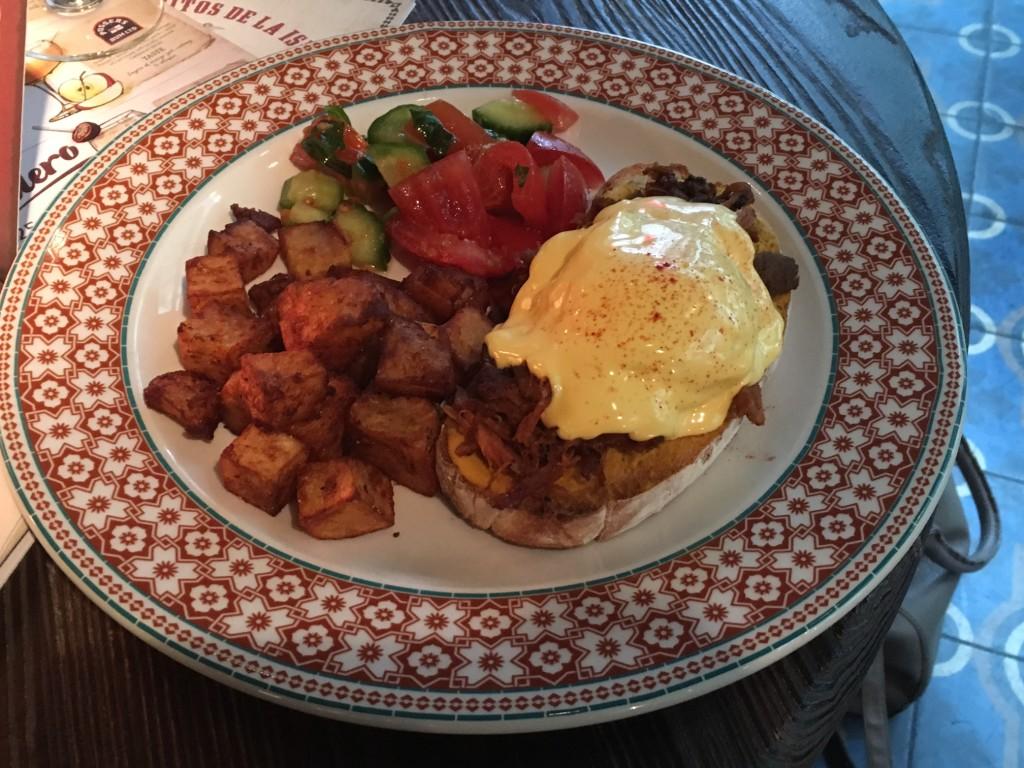 Cuban Benedict (eggs benedict with pulled pork), avocado, tomato and crispy potatoes