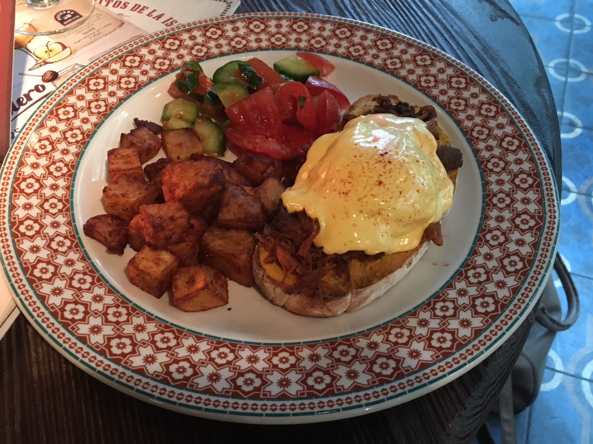 Cuban Benedict (eggs benedict with pulled pork), avocado, tomato and crispy potatoes