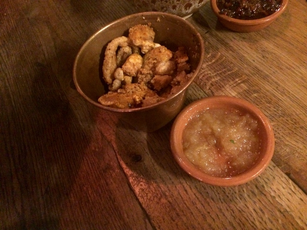 Pork scratchings with spiced apple chutney