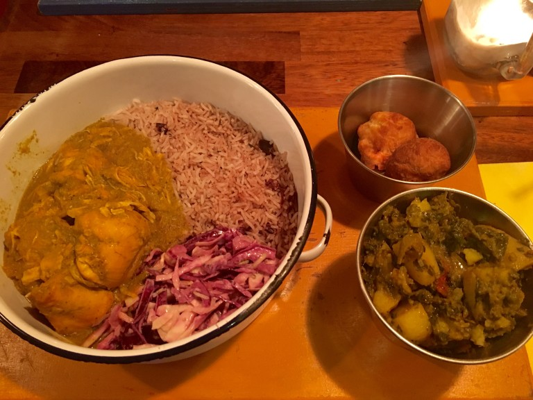Chicken curry, rice n' peas, Caribbean slaw, dumplings and callaloo