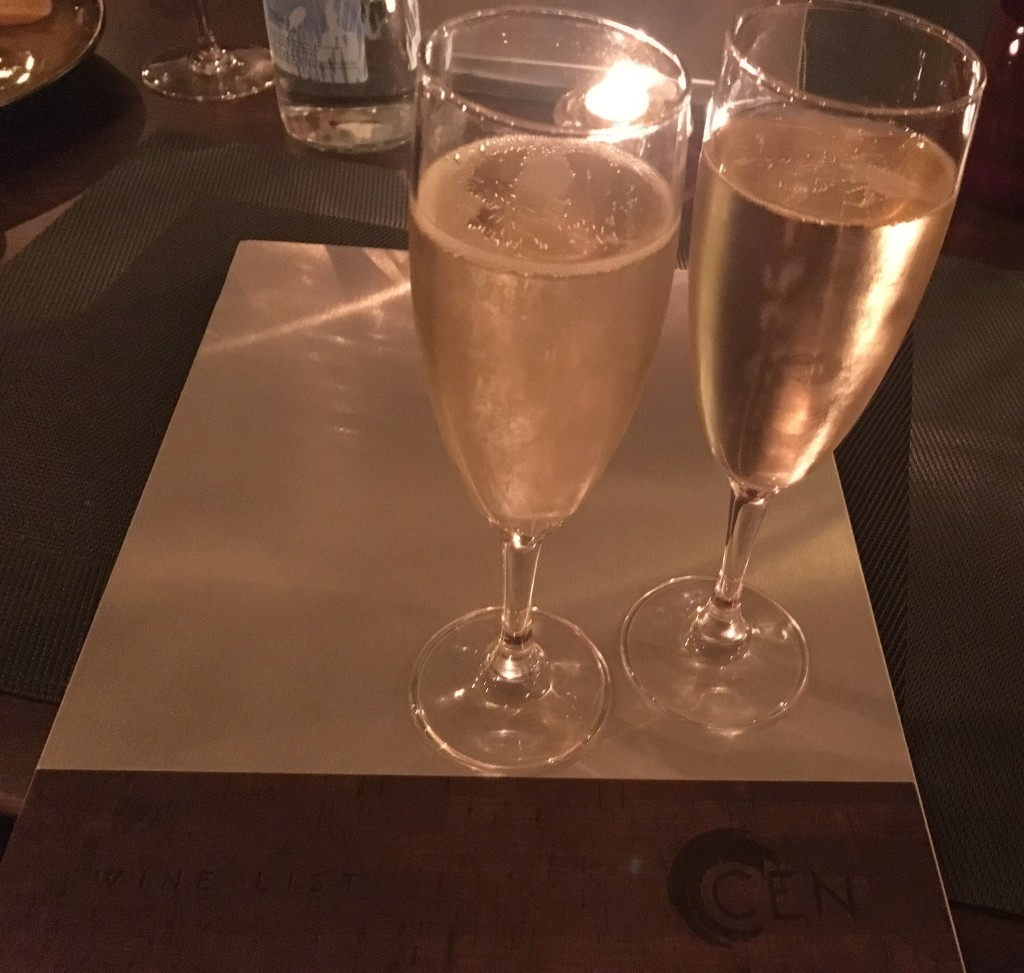 Two filled champagne glasses
