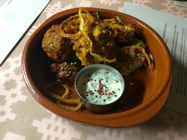 Indian street food tray with pakora, paneer, onion bhaji etc