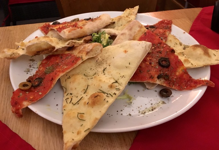 Garlic pizza bread and tomato and olive pizza bread