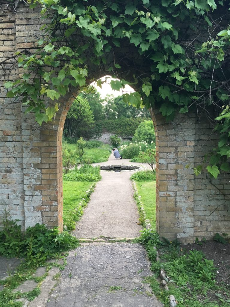 Archway in the historic walled gardens at Dunraven bay