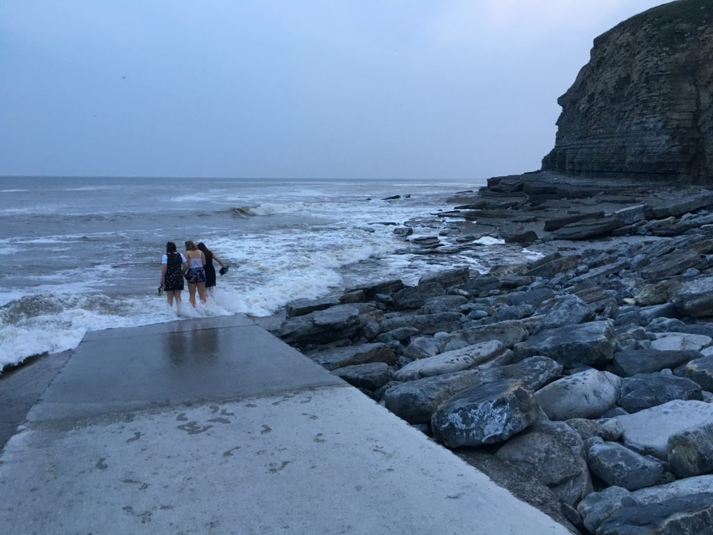 Paddling in the waves at Dunraven Bay
