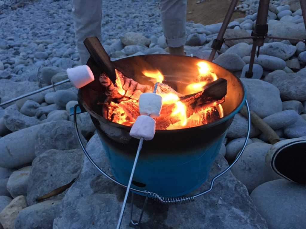 Roasting marshmallows on a beach fire
