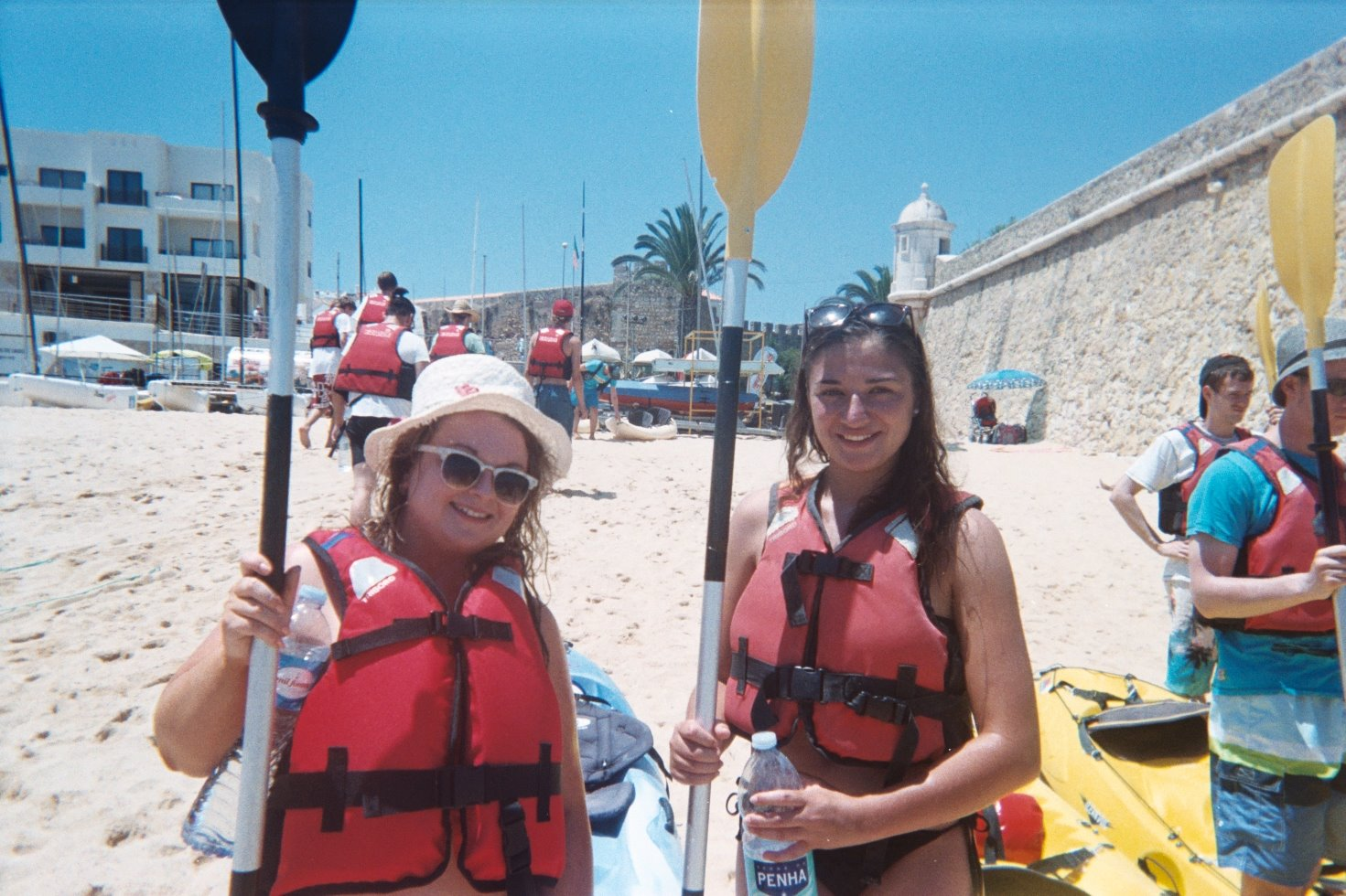 Holding our paddles, about to go kayaking in Lagos in the Algarve, Portugal