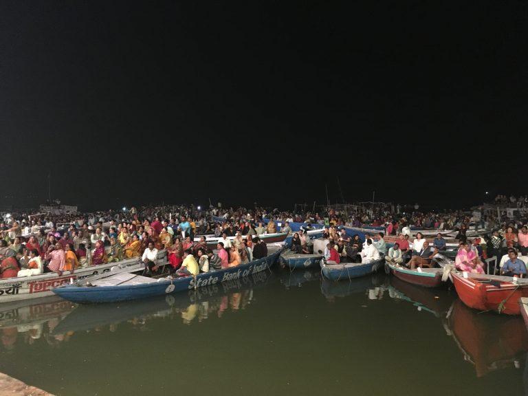Tourists on boats watching Ganga Aarti in Varanasi