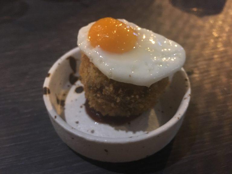 Corned beef hash, fried quail egg