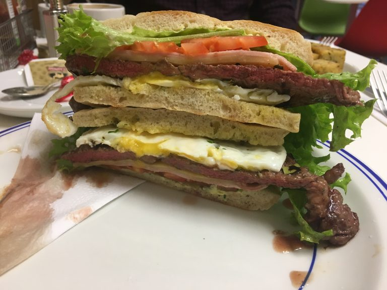Prego Especial sandwich of steak, egg, tomato, lettuce, garlic butter