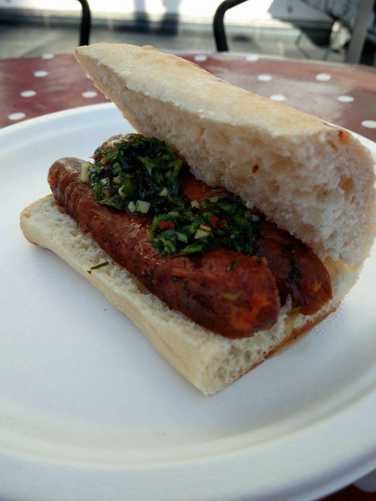 Sausage with chimichurri in ciabatta