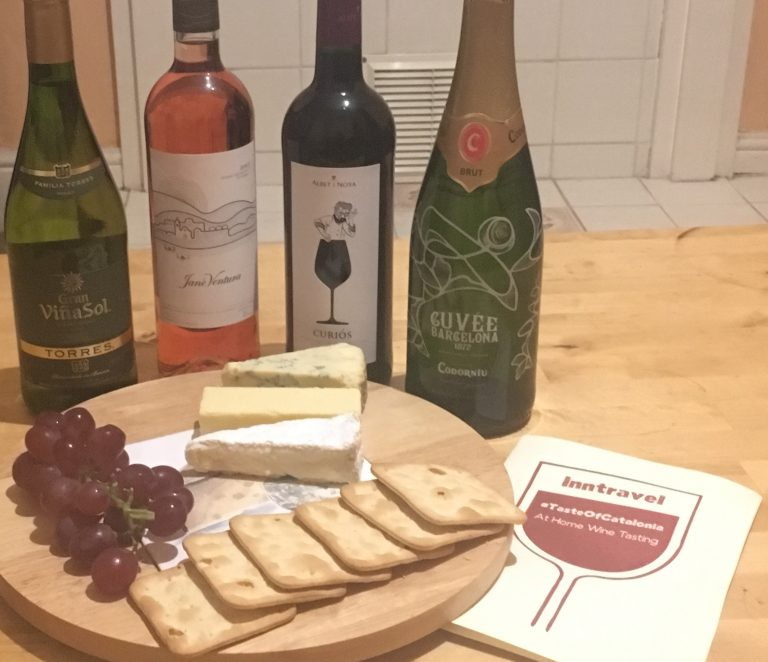 Wine, cheeseboard and grapes