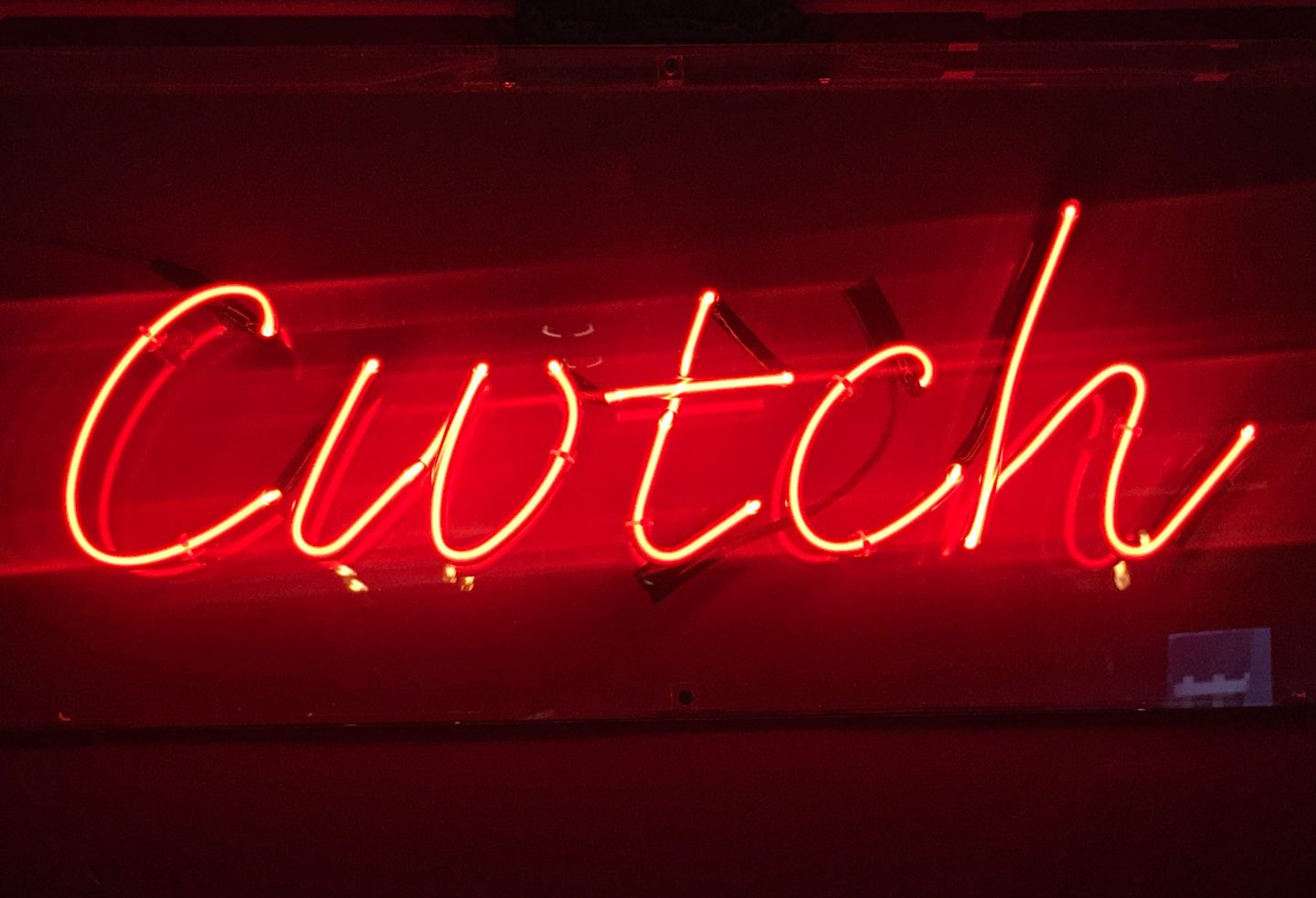 Cwtch neon signage at The Woodville pub, Cathays