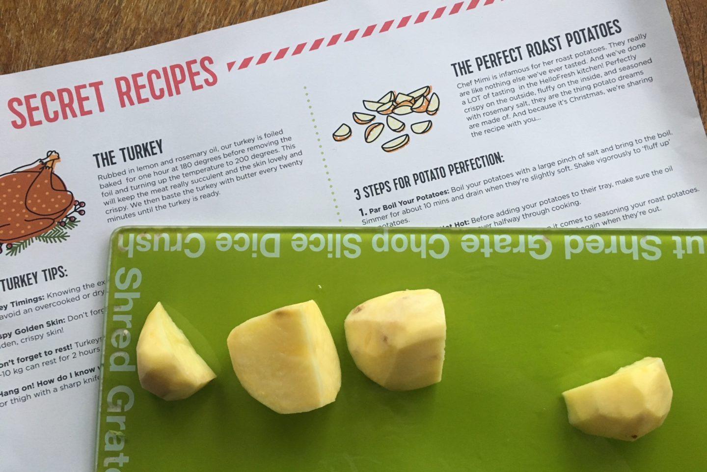 Roast potatoes on a chopping board