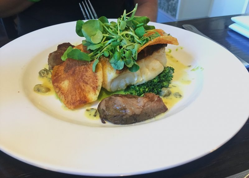 Pan-roasted cod loin, cider-braised pig cheeks, homemade crisps, pea puree and saffron tartare sauce - The Lemon Tree in Wrexham, North East Wales