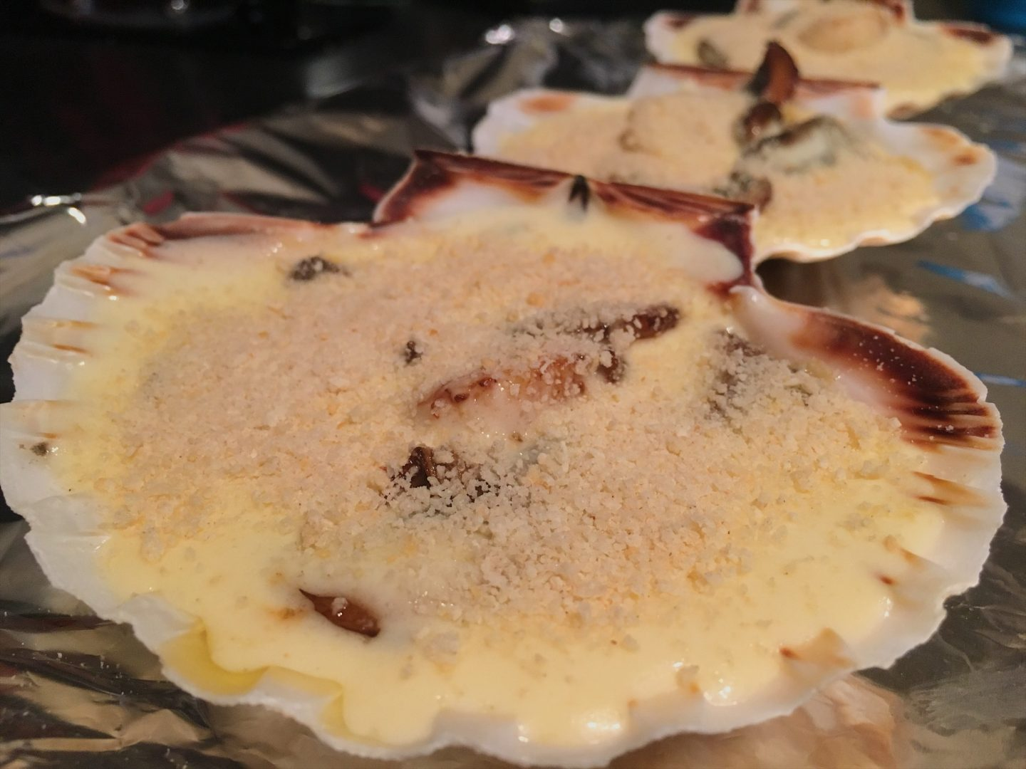 Scallop shells filled with mushrooms, scallops and a creamy white wine sauce (making coquilles St Jacques)
