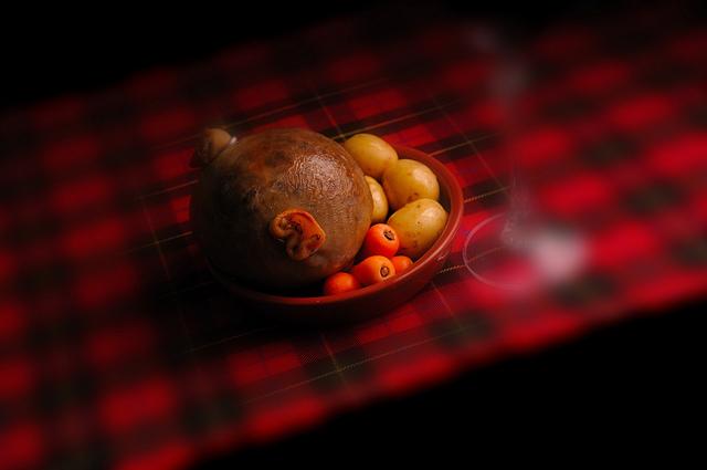 Haggis, tatties and neeps on a tartan tablecloth
