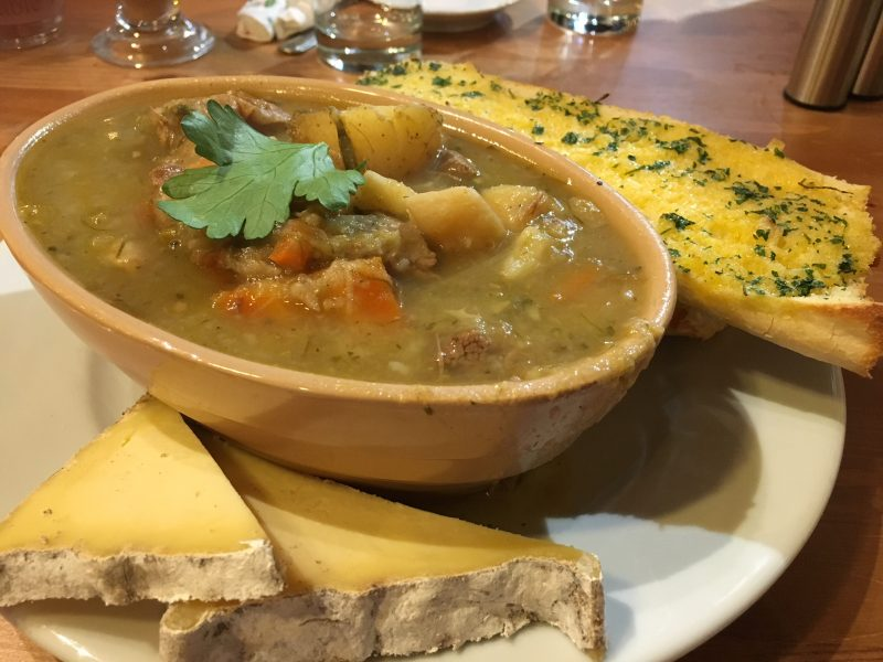 Welsh lamb cawl served with cheese and bread; one of the most comforting British foods