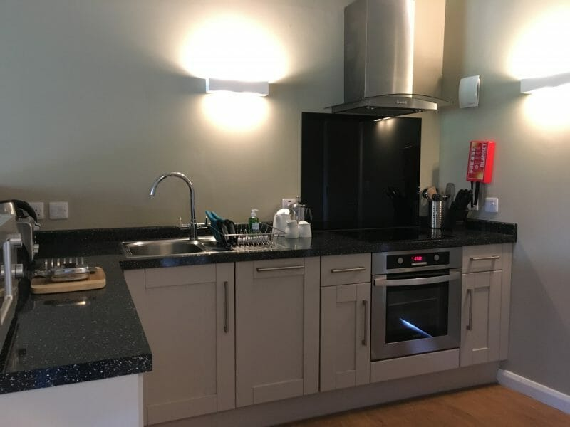 A kitchen with worktop space, cupboards, an oven and a hob at Bluestone Wales