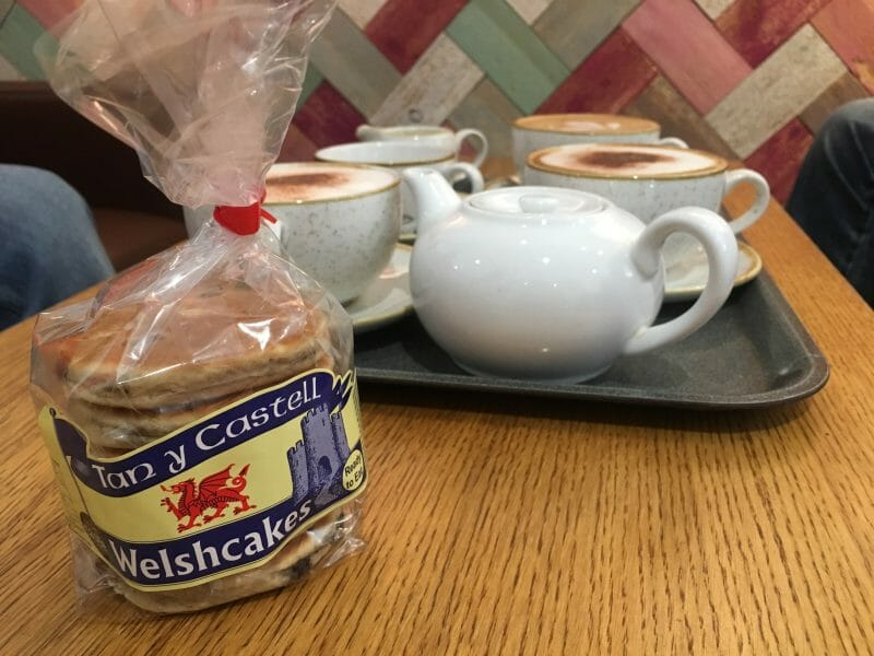 Tan-y-Castell Welshcakes and a tray holding a pot of tea and several cups of coffee