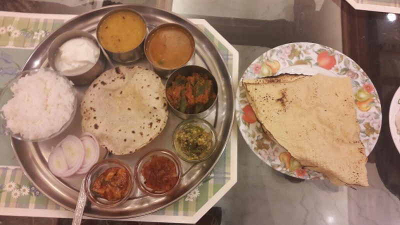 A traditional veggie thali served in a Kolkata household - a delicious world food.