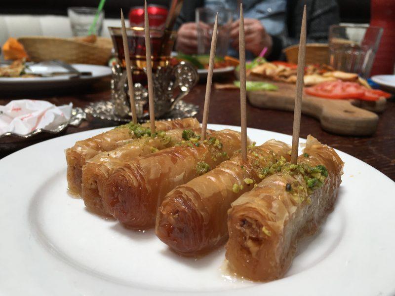A saucer holding five kadayfi baklava sweets