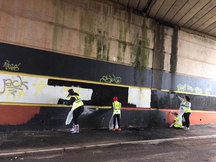 Painting over graffiti at Caerau Ely F.C in a litterpick organised by McDonald's Cardiff and Keep Wales Tidy