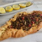 Turkish Kymani (mincemeat) pide served with fresh slices of lemon