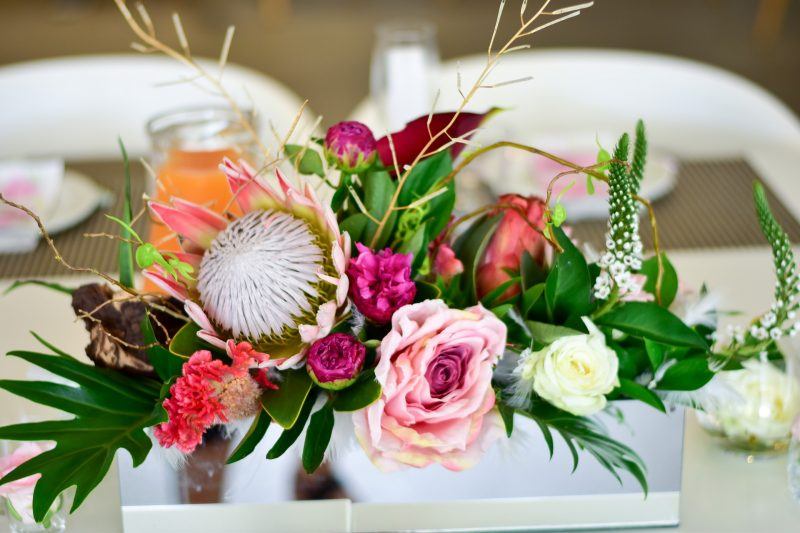 A flower arrangement on a table, ideal for a summer party