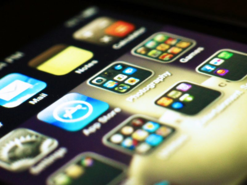 Apps on an iPhone screen - playing games is a great way to stay entertained on a long-haul flight