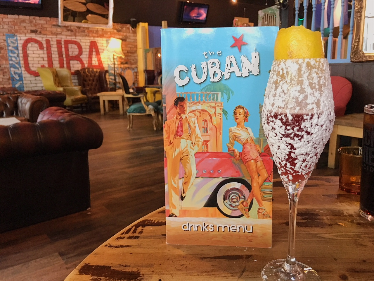 The signature cocktail 'Last Day in Cuba' at The Cuban restaurant, Bristol - the glass is covered in icing sugar.