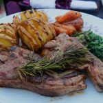 ak-smoked lamb chops with garlic and rosemary, teamed with kale, roast carrots and Hasselback potatoes - the main course in the Welsh three-course dinner menu