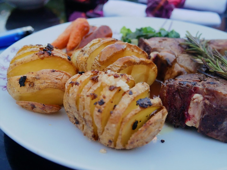 Crispy Hasselback potatoes topped with roasted garlic sea salt