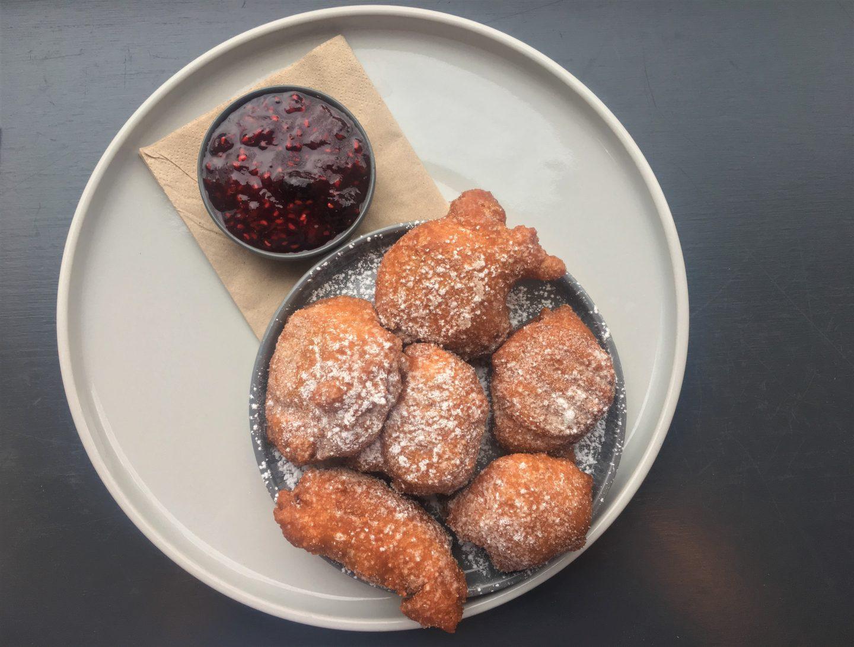 Italian Zappoli doughnuts with raspberry jam