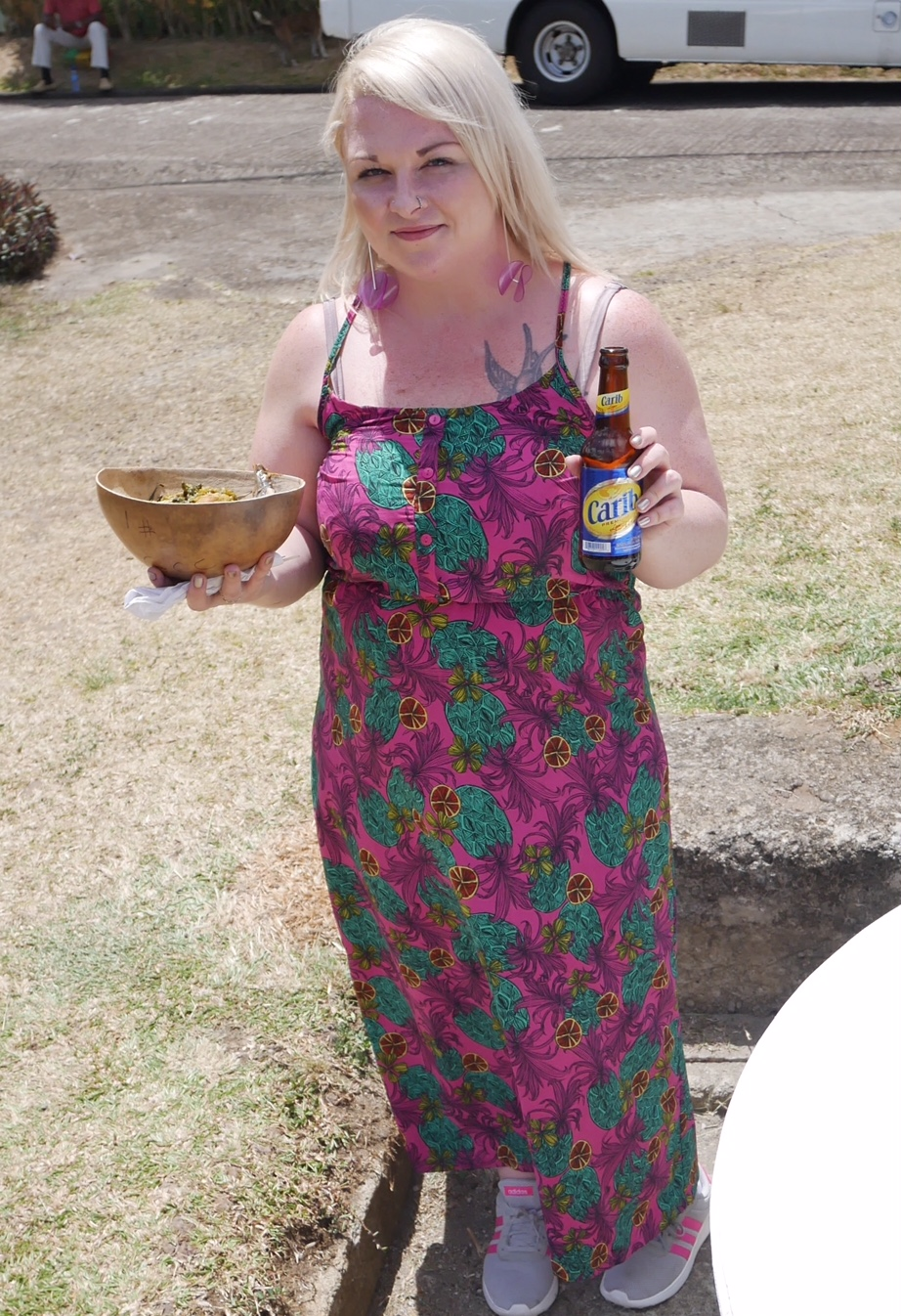 Tucking in to Grenada's national dish, oildow washed down with Carib beer at Grenada Chocolate Company